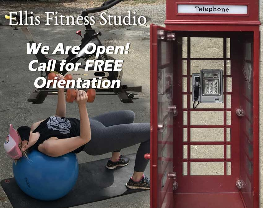 Ellis Fitness Studio - Call for FREE Orientation visit ellisfitnessstudio.com for more details - Woman with fitness equipments and a phone booth